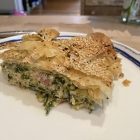 Filo pot pie piled with greens